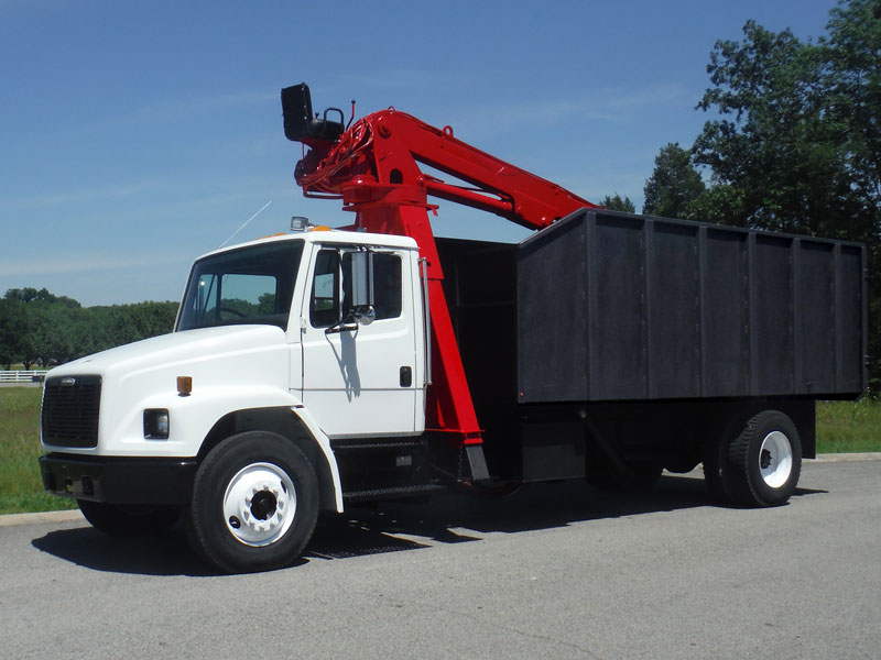 red, black, and white bucket truck that has been restored by Utility Equipment Services in TN