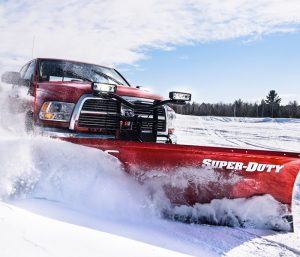 Red heavy-duty pickup truck with Super-Duty snow plow